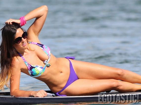 claudia-romani-paddleboarding-in-a-thong
