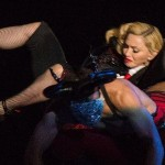 The moment Madonna, 56, falls BACKWARDS down a set of steps after being pulled by dancers at BRIT Awards
